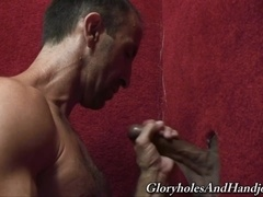 Steven Richards enjoys sucking and rubbing a gloryhole boner