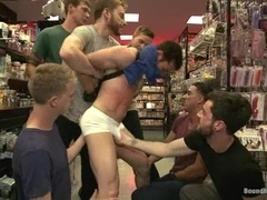 A brunette queen gets his ass and mouth pounded in a shop