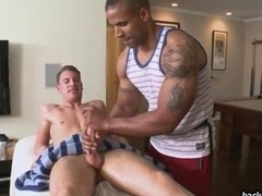 Large muscle guy massages a hard dick