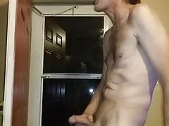 Cumming at open door