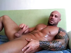 Muscled guy with tatoos Jerking