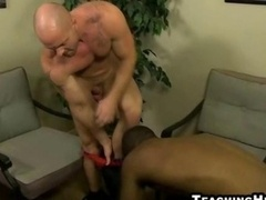 Aged muscular stud shoves his love tool in a black lad