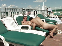Hot hunk is sucking his partner's long pole outdoors