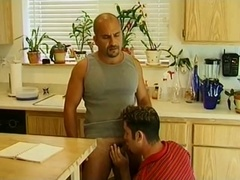 Bald queer rides his BF's dick after sucking it in the kitchen