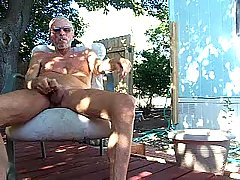 Grey-haired mature gay masturbates outdoor