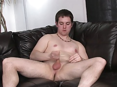 Shorthaired guy's legs are spread open and his cock is stiff as a rock
