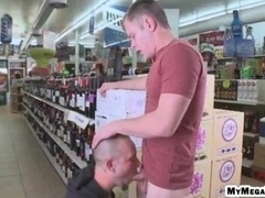Man giving his familiar a dick sucking inside the liquor store