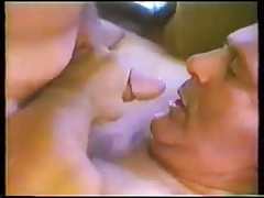 Two mature men sucking