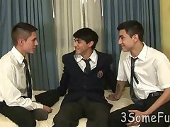 Cute college boys kiss and eat meat in a threesome