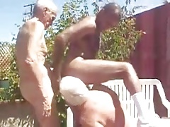 Two white grandpa and black boy