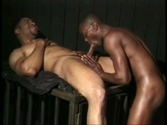 Two ebony queers enjoy face-fucking each other indoors