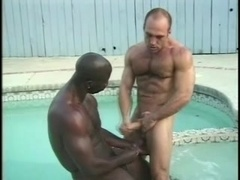 Two muscular dudes enjoy interracial gay sex on the poolside