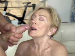 Blonde granny bangs a young stud and gets a facial