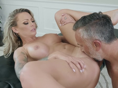 A hot blonde bitch that loves licking balls is taking care of cock