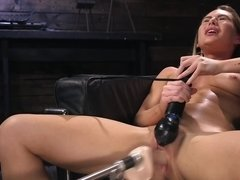 Girl with pierced nipples satisfies herself in solo scene