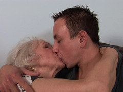 A fat granny is getting fucked by a shorty haired dude on the sofa