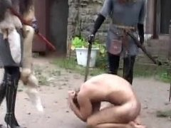 Medieval slave spitted kicked & smeared out outdoors by three femdom