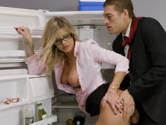 Office workers secluded at the kitchen to have some fun