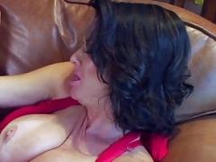 A lady masturbates in the mouth of a young fella