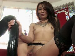 A brunette that loves her huge dildo is jacking off nicely