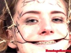 Teen sub dominated with open mouth gags