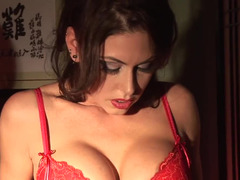Solo Jessica Jaymes masturbates in black stockings