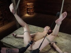 Redhead's legs are tied wide open and she is ready for stimulation