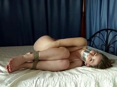 Beauty hogtied naked in the bed