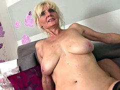 Super mom with big saggy tits takes young cock