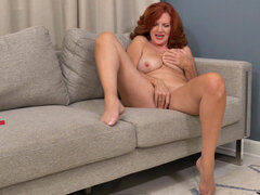 Luscious mom Andi James shows off the natural red hair of her lusty muff