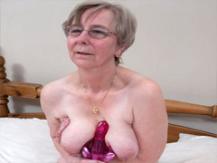 Eye-glassed Granny Plays With A Rubber Dildo