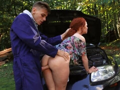 Big-cocked guy fucks the redhead as payment for fixing her car