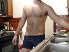 Chubby guy cooks naked in the kitchen