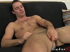 Handsome stud teases before a cum blasting jerk off