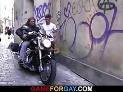 Muscle biker seduced by gay stranger