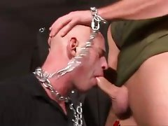The guard is forced to take the cock in his mouth