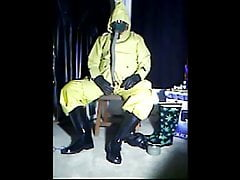 Wanking in yellow rubber.