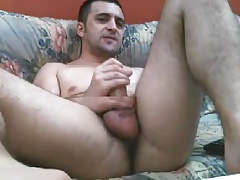Sexy dude wanking and playing with ass