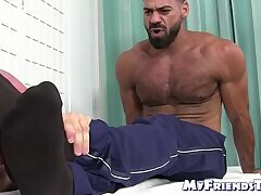 Bald gay masturbates his cock while sucking hunks feet