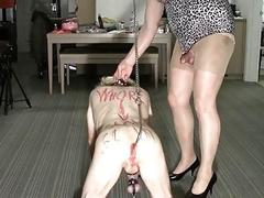 Crossdressers play out a humiliating BDSM scene