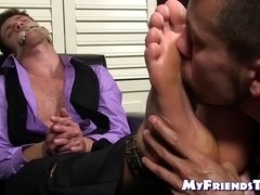 Tied up businessman endures feet tickling and toe sucking