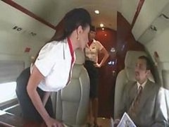 Sweet stewardess is getting down and dirty with a duo businessmen on the board of a plane