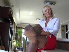 Hot MILF in pantyhose footjob video