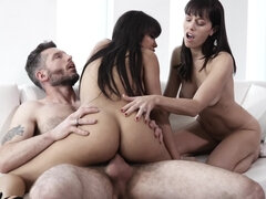 Two petite brunettes sharing a cock in a steamy threesome