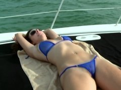 Hot girl in a blue bikini gives blowjob to bald captain