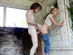Pretty slut with a nose ring takes cock in a condemned building