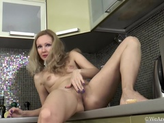 Foxy masturbates in her kitchen with passion