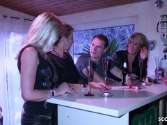 Three German MILFs in stockings do young stud