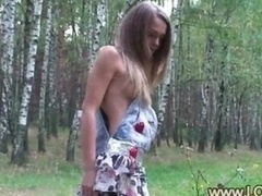 Undressed 18yo chick stripping in the forest