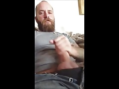 Hot bear strokes his dick and cum